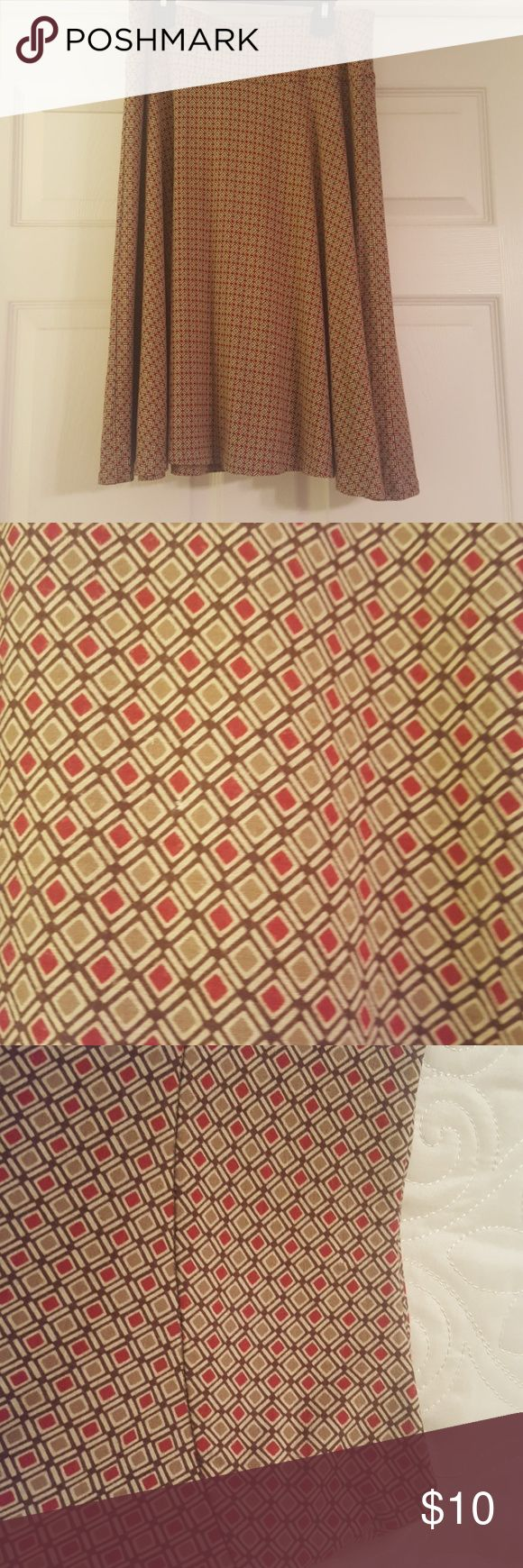 New York and Company geometric print skirt size S. New York and Company geometric print skirt size S. Great used condition. Beautiful red, gold, and brown colors. Wide waist band with a swing style. Has a lining inside.  Non smoking home. New York and Company Skirts A-Line or Full