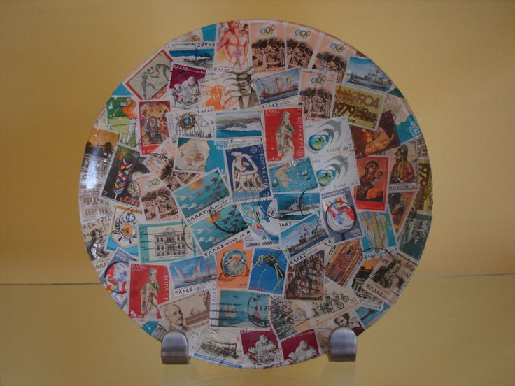 Decoupaged plate with old stamps.