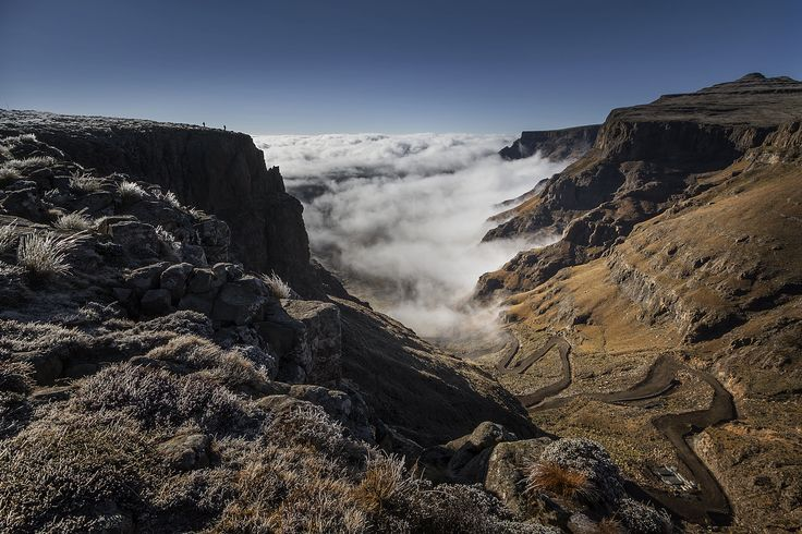 From the top of Sani Pass - a notorious road from Kwazulu-Natal in South Africa to Lesotho. Early morning and the valley was filled with mist. Moments later the mist had enveloped all and remained for the rest of the day | Photography by Helen McFadden