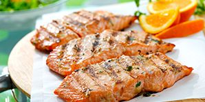 This Asian-inspired marinade blends ingredients found in teriyaki sauce with orange juice and chili flakes for a twist. Canola oil showcases these ingredients while protecting the salmon on the grill.