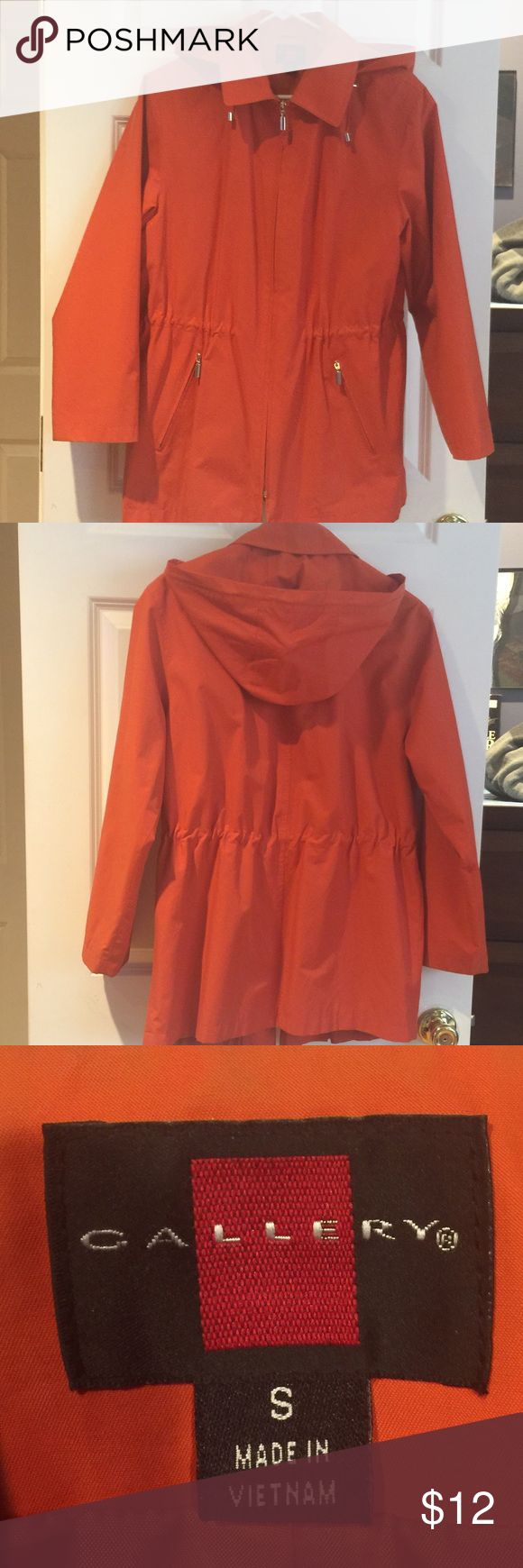 Women's Rain Jacket Women's rain jacket by Gallery. Orange color. Has a detachable hood & toggles inside to cinch the jacket in at the waist. I purchased this at Macy's & only wore it once. It's a nice lightweight spring jacket, even in the sun! ☂️☀️ Gallery Jackets & Coats Trench Coats