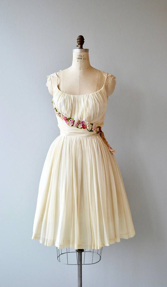 Vintage 1950s off white silk chiffon dress with lovely gathered bodice, fitted waist, candy-colored velvet flowers across the bodice to the side of the waist terminating with a floppy tie with velvet flowers, layered silk chiffon skirt and metal zipper. This would make a very sweet wedding