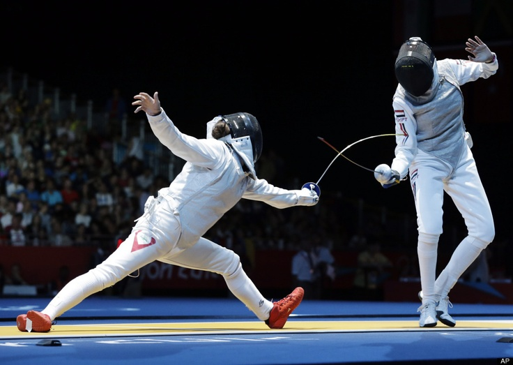 Mona Shaito of Lebannon, left, and Shaimaa Elgammal of Egypt talk compete in the round of 64 during women's fencing at the 2012 Summer Olympics, Saturday, July 28, 2012, in London. Shaito won.