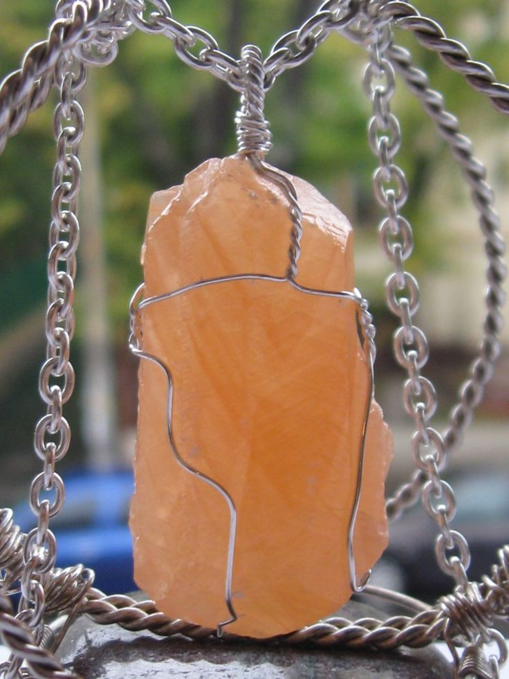 Coral calcite pendant wire wrapped in sterling silver & silver necklace