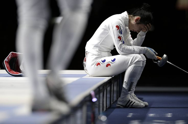 South Korea's Shin A Lam reacts after being defeated by Germany's Britta Heidemann during their women's epee individual semifinal fencing competition at the ExCel venue at the London 2012 Olympic Games July 30, 2012. Losing at the Olympics hurts. But suffering an injustice, real or imagined, is agony.