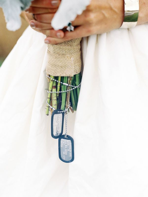 dog tag bouquet wrap, photo by Sarah Der Photography http://ruffledblog.com/rustic-virginia-wedding #weddingideas #dogtags