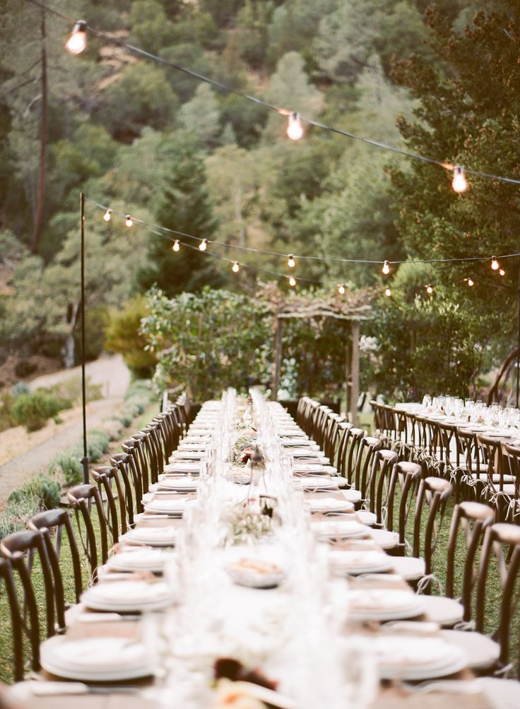 Cole Drake Events wows us with this impeccable farm table wedding reception at Calistoga Ranch. Lovely photo from Sylvie Gil Photography.  #encoreeventsrentals #farmtable #weddingreception #winecountry #ranchwedding #weddingdesign