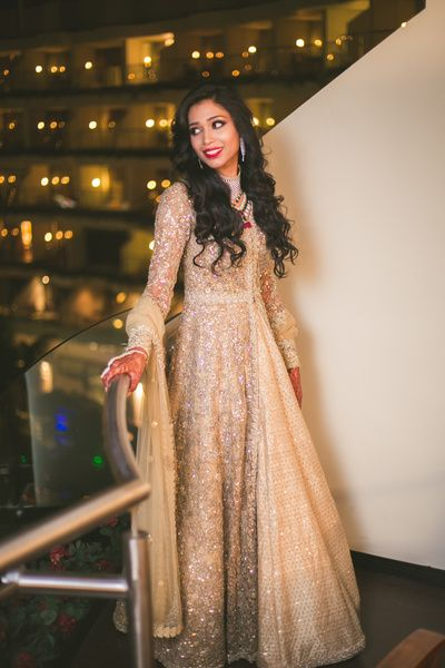 Shimmery gold jacket lehenga , full sleeves jacket lehenga , gold engagement outfit