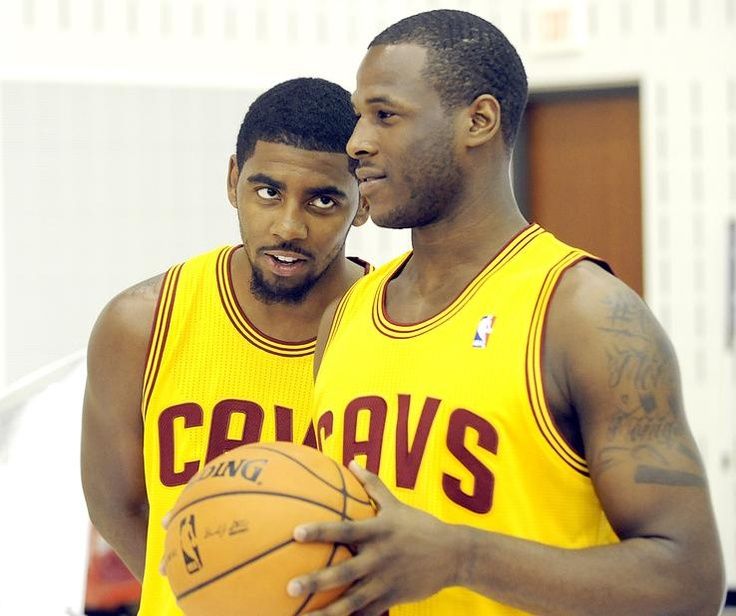 Cleveland Cavaliers guard Kyrie Irving, left, watches guard Dion Waiters as they have their photos taken during their NBA basketball media day at the team's training facility in Independence, Ohio, Monday, Oct. 1, 2012.
