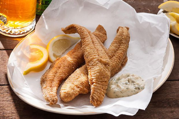 An easy recipe for crunchy cornmeal-coated catfish that's shallow-fried and served with a tartar sauce–like rémoulade for dipping.
