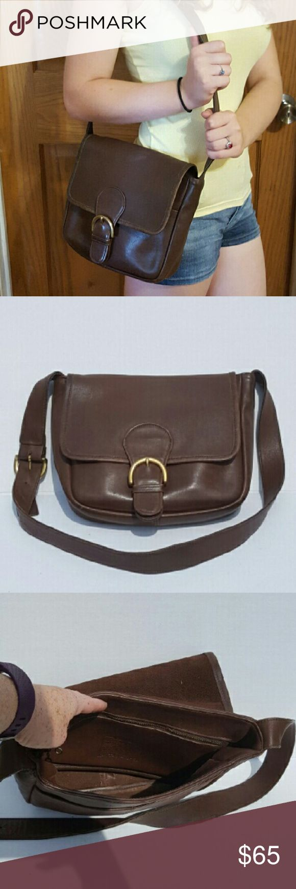 Vintage Coach Bedford Flap Bag Made in USA. Brown glove tanned leather, original Coach hangtag, brass hardware, and adjustable strap with 13 inch drop . Has magnetic snap closure and slip pocket on both the back of the bag and underneath the flap. Inside has one large main compartment and a zippered privacy pocket. It does have some where is pictured in the last picture of us do to loving use. Measures approximately 9(L)x 9.5 (H)x 3 (D) Style No. 4164 Coach Bags Shoulder Bags