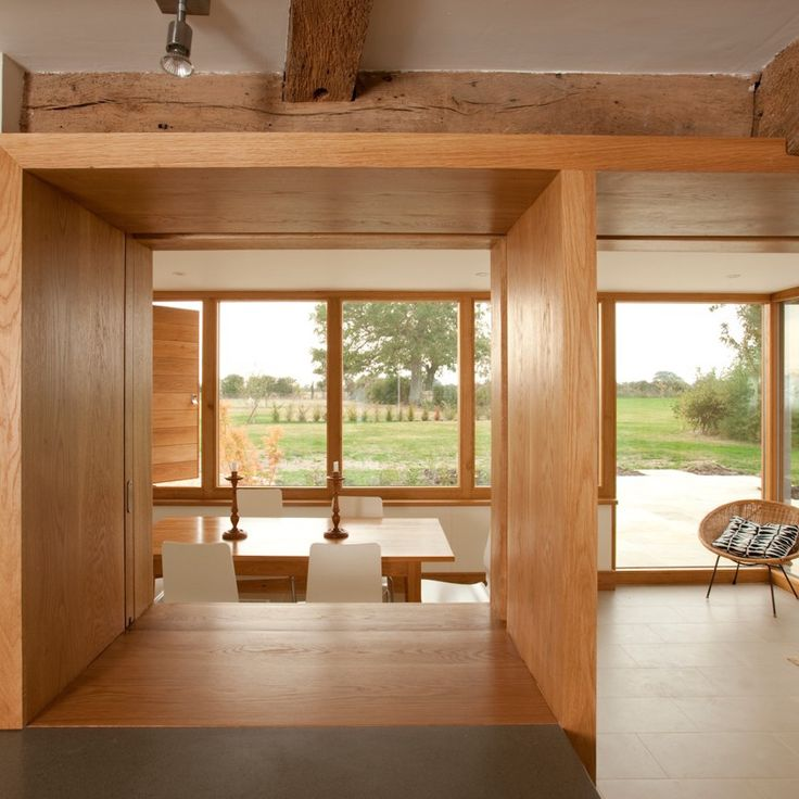 Modern extension to listed Norfolk farmhouse  View from old part of house through extension to garden