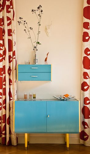 Love the blue painted retro furniture and the curtains