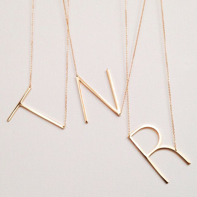 These large initial necklaces are a gorgeous statement piece.