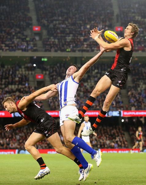 Joe Daniher of the Bombers attempts to mark over the top of Todd Goldstein of the Kangaroos during the round seven AFL match between the Essendon Bombers and the North Melbourne Kangaroos at Etihad Stadium on May 15, 2015 in Melbourne, Australia.