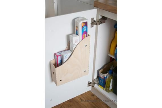 •❈• DIY Rack A little imagination can put the backs of cabinet doors to good use. Here, a mail-order magazine filing box ($5) makes a handy holder for odd-size items, putting them close at hand when the door is opened. Note that the second shelf of your cabinet has to be recessed for this trick to work.