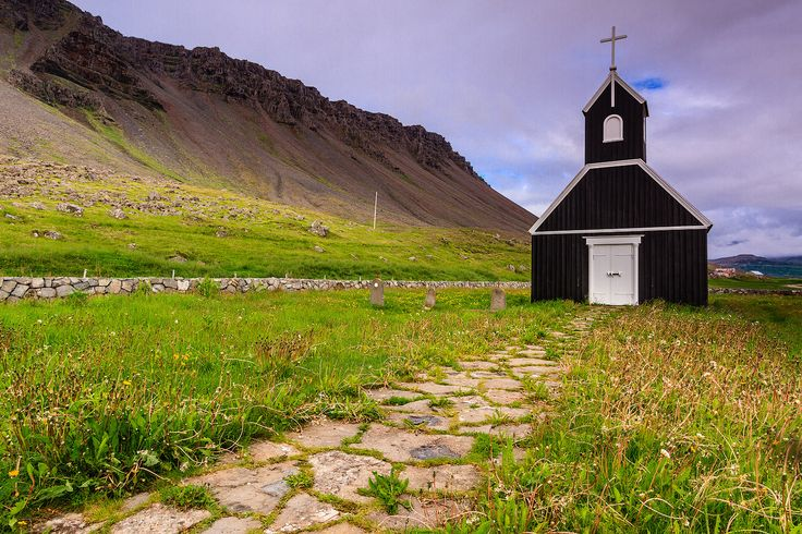 The Rauðisandur black church is one of the 3 black churches in Iceland. They are black because the exterior wood is painted with pitch, just like the hull of a boat. This is to protect it from the harsh Icelandic elements. This works fairly well and buildings treated in this way have survived over 100 years.