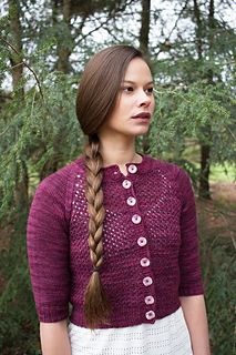 This cropped lace cardigan goes great over dresses and skirts - or just a tee and jeans! The body is worked in one piece to the underarm, then joined with the elbow-length stockinette sleeve to work a seamless raglan yoke.