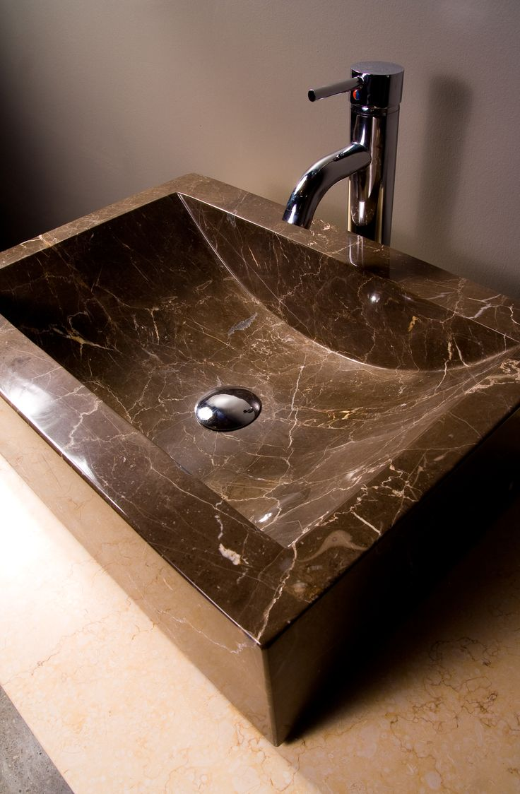 A darker, beautiful stone sink.