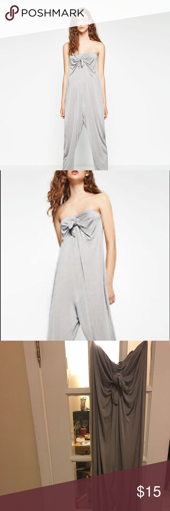 ZARA Silver jumpsuit with Bow detail...worn once Chic and comfy silver jumpsuit! I love this piece. I wore it once and got so many compliments!!!! Zara Pants Jumpsuits & Rompers
