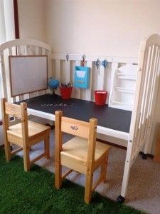 Remove one side of the crib and voila! There you have an instant craft table.  Paint the new table with chalk board paint and hang a white board, hooks and shelves for organisation.