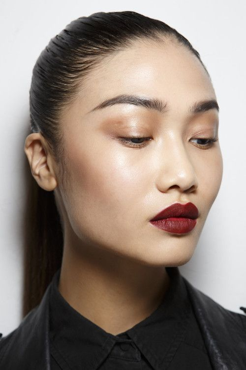 Red lips and light copper eye shadow