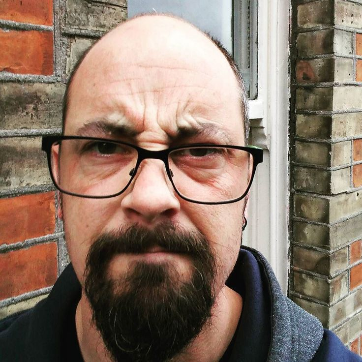 """Just been stopped in the street & asked """"Where's a decent place to get a haircut around here?"""" HOW WOULD I KNOW?! #LoveBodmin #pisstake #haircut #bald #grumpy #grumpyface"""