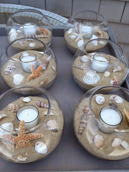 DIY beach themed Wedding Table Center Pieces - seashells, sand, tea light candles, glass bowls -- these would also look beautiful on a covered patio, or an end table. Description from pinterest.com. I searched for this on bing.com/images