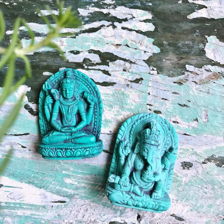 Pocket Gods    Shiva (new beginnings) and Ganesha (removes obstacles) in pocket size or for a small altar.  They are about 2 inches in size and come with a mini velvet bag to keep them safe.  Made in Nepal
