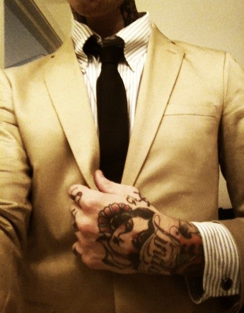 I love that he's in a suit. And if you can pull it off, and they mean something, tattoos are sexy to me.