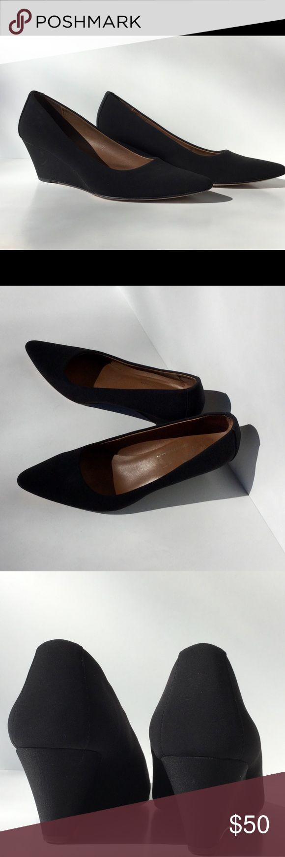 Donald J. Pliner Black Wedge Heel Donald J. Pliner dark black fabric wedge. Pump look in a comfortable wedge with a 2 1/2 inch heel.   Donald J. Pliner quality with a leather sole. Vero Cuoio. Size 8M.   In great shape. Worn a few times. Donald J. Pliner Shoes Wedges