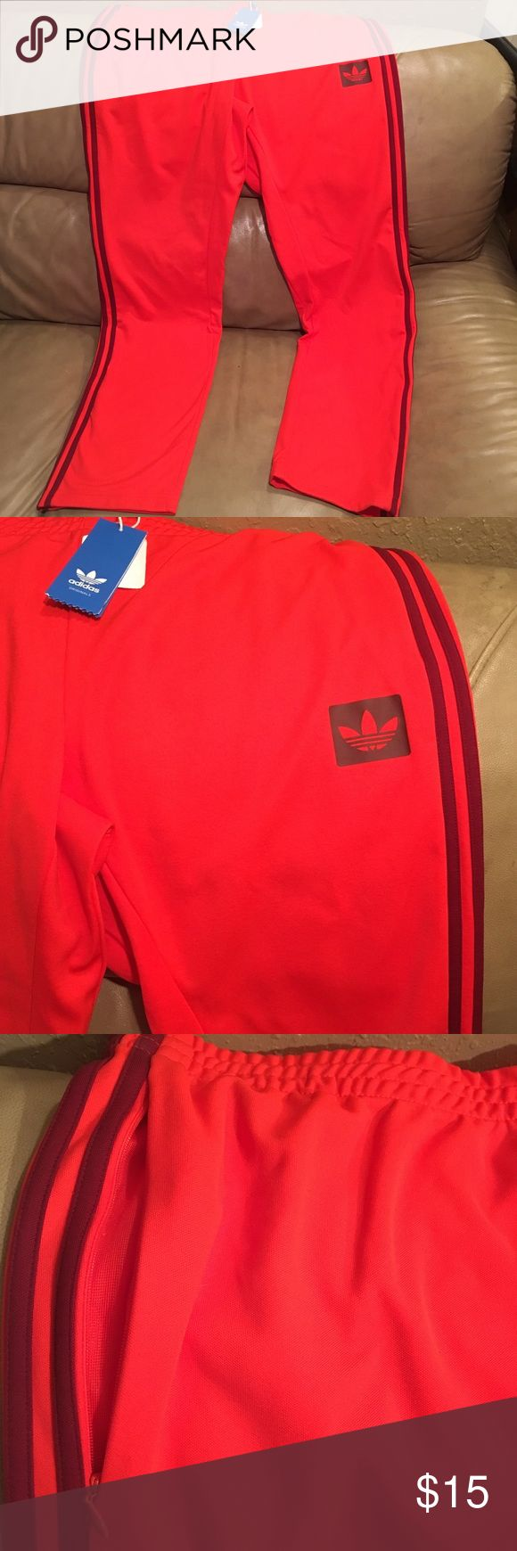 MENS ADIDAS WARM UP PANTS BRAND NEW These vibrate Adidas pants are great brand new with tags size XL adidas Pants Sweatpants & Joggers