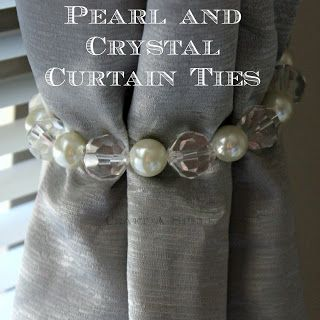 make your own curtain tie backs.. Cheap pearl or crystal bracelet from fashion store etc.. Cute..