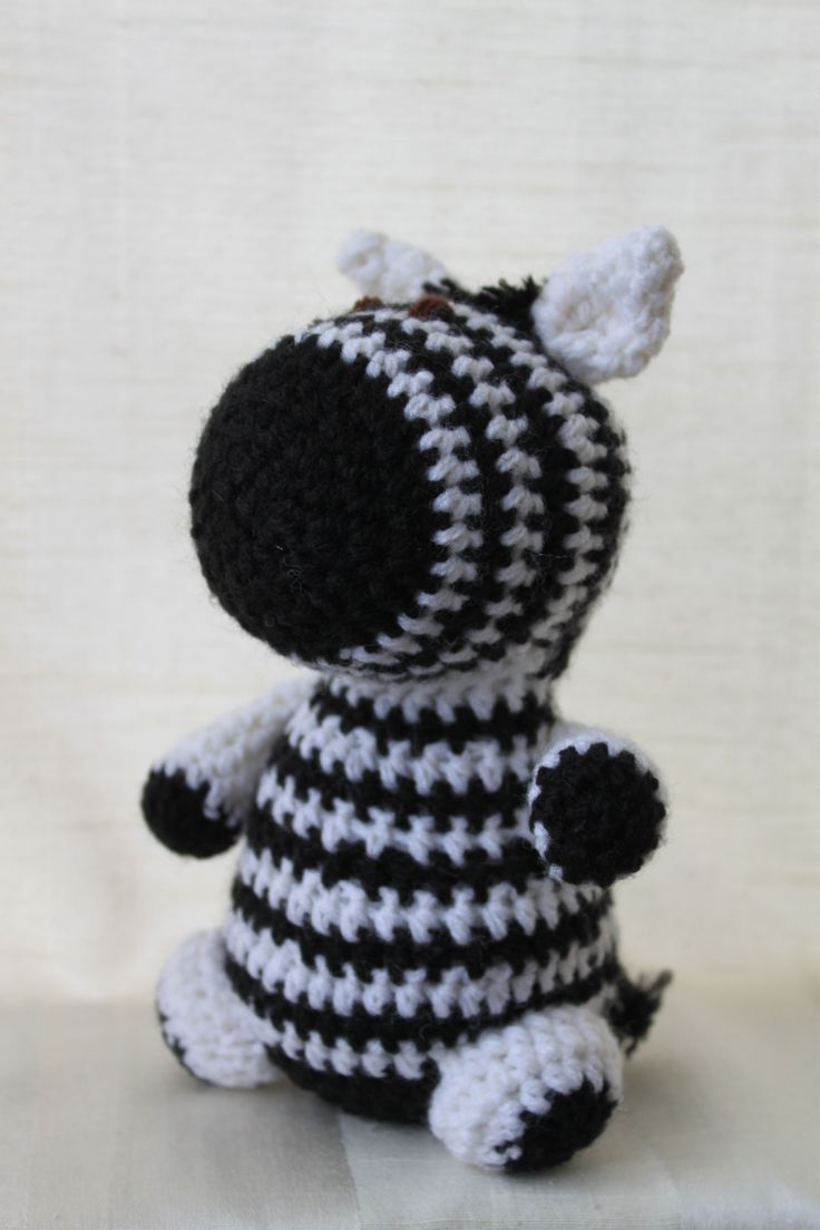 Zack the zebra. Amigurumi plush animal. The animal is approximately 20 cm tall.