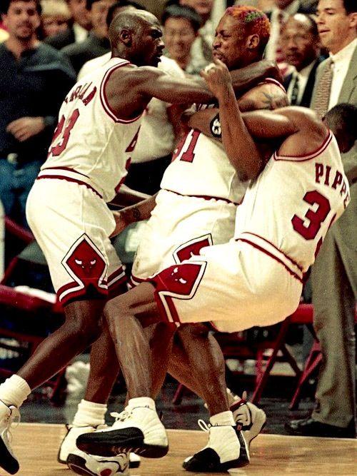 "Michael Jordan & Scottie Pippen holding back Dennis Redman • ""Chill, bro"""