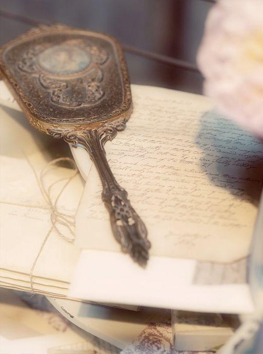 vintage mirror & grandma's soft matching brush on her vanity