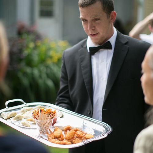 Real Weddings - In Bliss Weddings: Waiters in tuxedos served hors d'oeuvres to the hungry guests. Photo credit: Jamie Bodo Photography