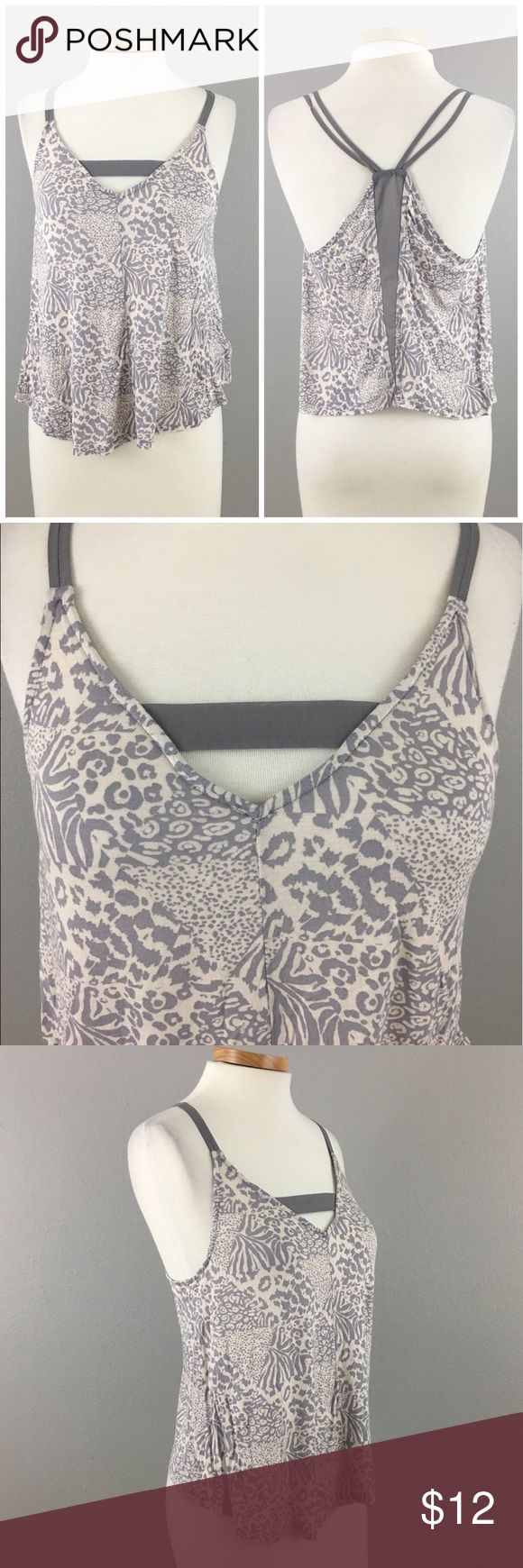 Silence & Noise Animal Print Lilac Strappy Tank Silence & Noise Animal Print Lilac Strappy Tank. Size small. Purchased from urban Outfitters.     Thank you for looking at my listing. Please feel free to comment with any questions (no trades/modeling).  •Condition: EUC, no visible flaws.  25% off all Bundles or 3+ items! Reasonable offers welcome. Visit me on INSTA @reupfashions. JC silence + noise Tops Tank Tops
