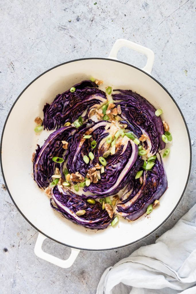 Roasted red cabbage is a simple side dish that is easy to make and full of flavour. Seasoned with fragrant Baharat, salt, and olive oil. A perfect vegetarian recipe and vegan recipe. #redcabbage #cabbage #roastedcabbage #roastedredcabbage #easysidedish