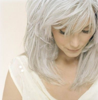 Emmy Lou Harris....beautiful gray and love all of the choppy layers.