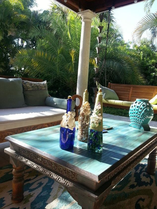 "Backyard Coastal Tiki Torches | Hometalk. Materials I used for this project:  Jute Twine (Home Depot) Short Rod Nut 1/2"" flare  (Home Depot)  Marbles (Dollar Tree) Shells & Sea Glass (the Beach) Weldbond Glue (Craft Store or Home Depot) WIck  (HomeDepot Garden or online search)"
