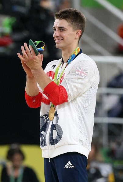 Gold medalist Max Whitlock of Great Britain poses during the medal ceremony for…