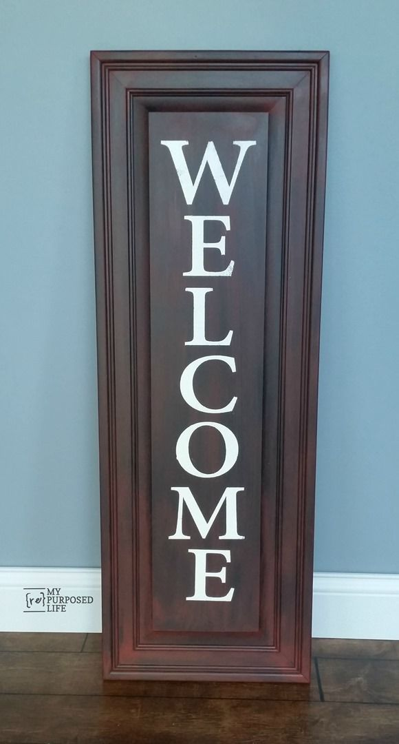 How to make an easy WELCOME sign out of a repurposed cabinet door. Paint and stenciling tips.