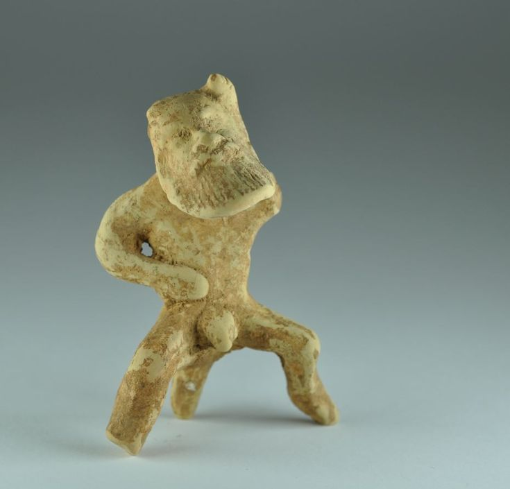 Greek archaic terracotta statuette of satyr, Greek, Corinth, mid 5th century B.C. Greek archaic terracotta statuette of Corinthian bearded sitting satyr supported by his tail, 7.8 cm high. Private collection