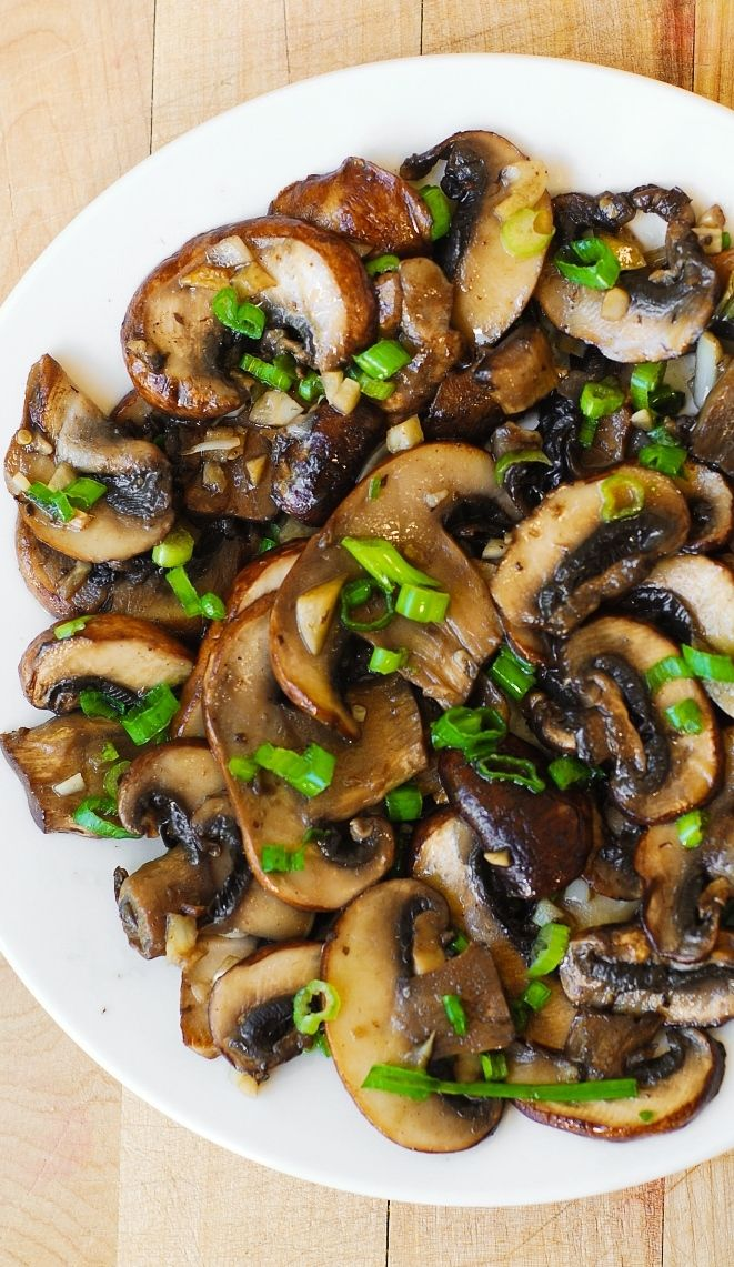 Mushrooms sauteed with garlic in olive oil and topped with green onions (or chives):