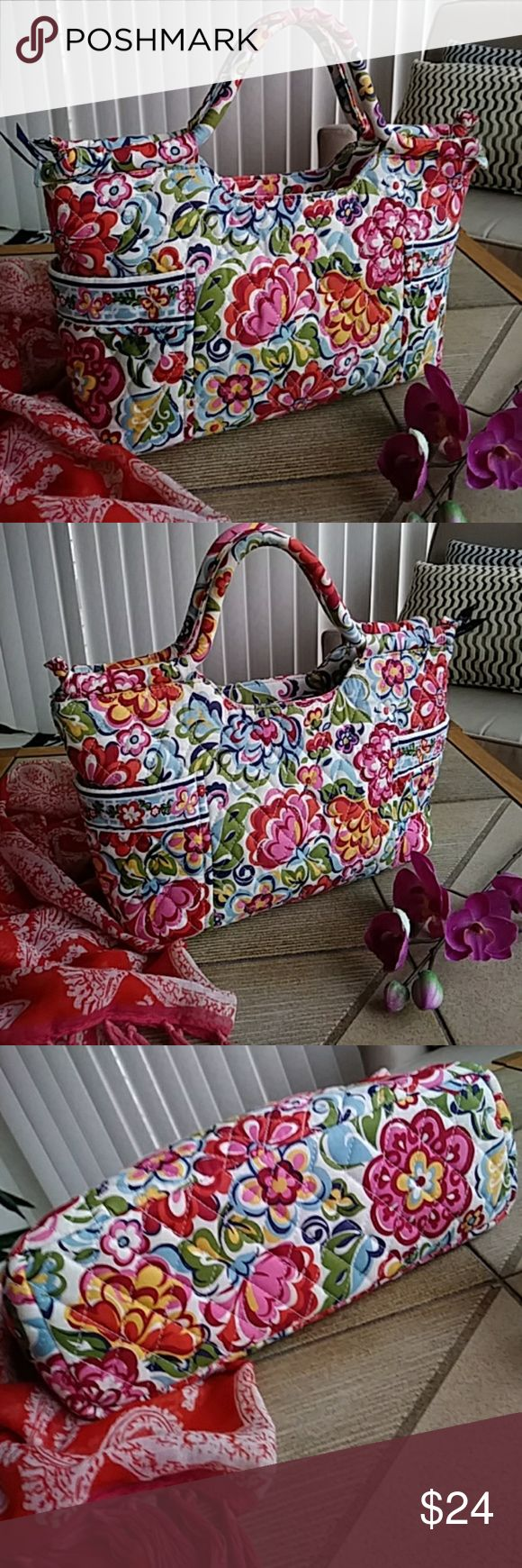 """Just in! VERA BRADLEY Hope Garden Gabby Bag VERA BRADLEY Hope Garden Gabby Hand Bag Purse. Retired. Features: zip top closure two exterior vertical pockets at sides, firm bottom (cardboard removable for laundering), interior zip pocket and three open organizer pockets. Preloved, EUC. 14"""" x 12"""" (including handles) x 4""""  Pink, rose, blue, yellow, orange, green, white.  Floral, Abby, Cotton, Print Vera Bradley Bags Satchels"""