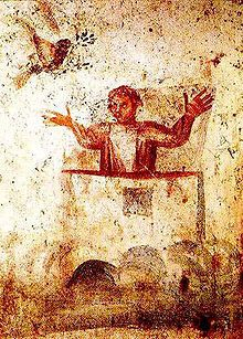 Wall painting from the early Christian Catacombs of Marcellinus and Peter in Rome, showing Noah, in the Orante attitude of prayer, the dove and an olive branch.