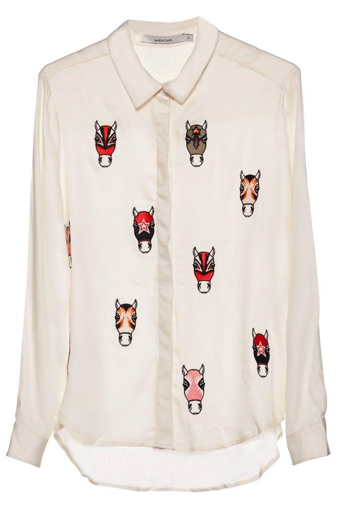 Camisa manga larga, con botones ocultos, calce suelto, tiene estampa de caballos de colores.    Pertenece a la nueva colección O/I 2015 de Maria Cher.