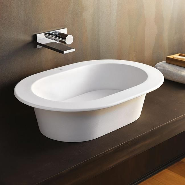 """""""Un design incisivo e raffinato che va oltre la grafica, oltre la decorazione."""" Si presenta così questo lavabo della CIELO ceramiche firmato Karim Rashid.  http://www.liberatosciolicasa.it/index.php?id_product=1579&controller=product#/8-colori-bianco"""