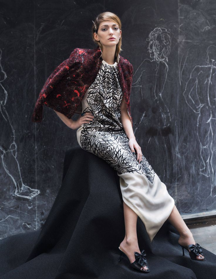 """When you put on a couture dress and see the layers of work underneath, that's when you really understand the art form,"""" Sanchez Barrenechea says. Jean Paul Gaultier Haute Couture cardigan jacket embroidered with organza ribbons and crystals, worn over a satin dress with jet black pearls; Gabriella Kiss bronze snake pin ($400); Amedeo cameo ring with citrine and tsavorite ($2,220); Les Chaussons de la Belle moiré mules ($580).   - TownandCountryMag.com"""